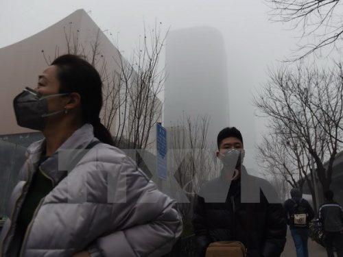 Khói mù bao phủ thủ đô Bắc Kinh ngày 22/12/2015 (Nguồn: AFP/TTXVN)