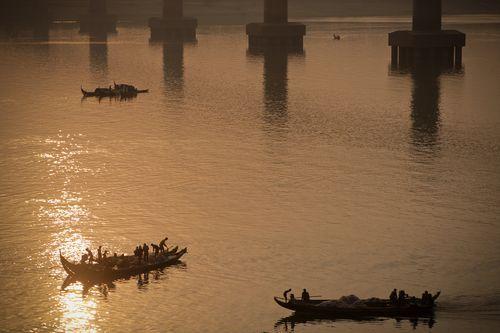 Ngư dân tại Kampong Cham. (Ảnh: Paulo Philippidis/ Flickr)