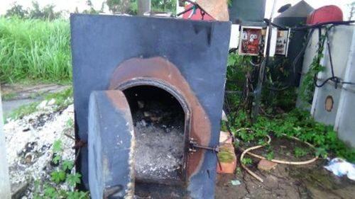 Lò thiêu xác heo tại Cty Việt Phước đã bị hỏng... (Ảnh: H.H)