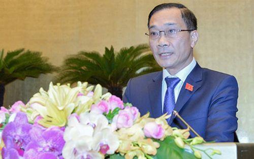 Ông Vũ Hồng Thanh, Chủ nhiệm Ủy ban Kinh tế của Quốc hội trình bày báo cáo trước Quốc hội.