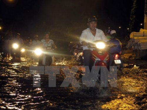 Ngập úng đường Phú Định, quận 8, Thành phố Hồ Chí Minh (Ảnh: Hoàng Hải/TTXVN)